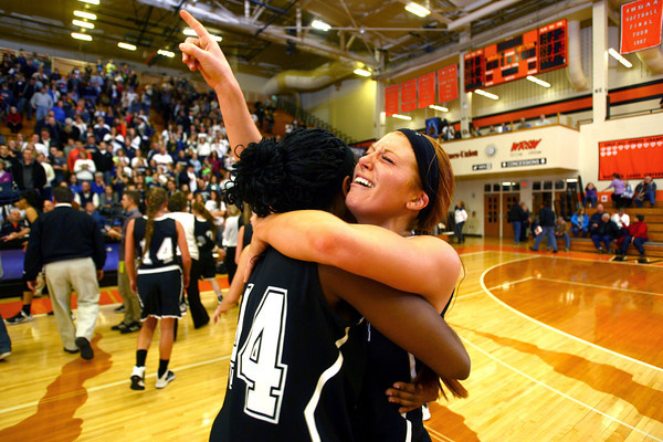 3-1-14  ---  Semi State girls basketball between Western HS and Norwell HS with western winning 41-31. Raven Black and Carley O'Neal hug after winning the game. -- <br /> KT photo | Tim Bath