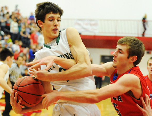 Globe/T. Rob Brown<br /> Seneca's Chance Smith attempts to take the ball from Mt. Vernon's Chandler Myers as they compete for a rebound Saturday night, Feb. 23, 2013, during the Class 3 District 12 Basketball Tournament at Seneca High School's gymnasium.