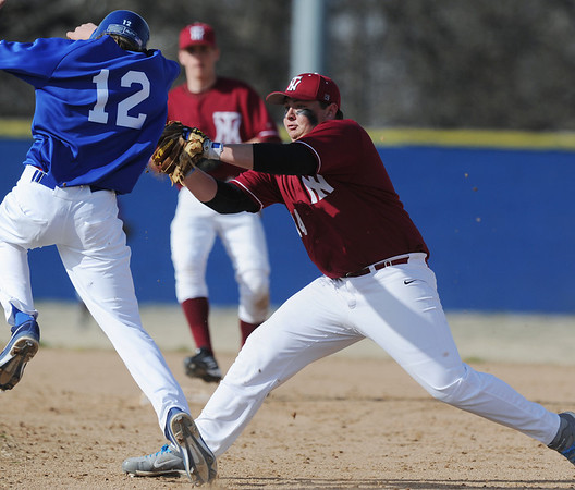Globe/Roger Nomer<br /> Nevada's Clay Regers tags Seneca's Cole Lankford for an out in Thursday's game at the Bill O'Dell Tournament.
