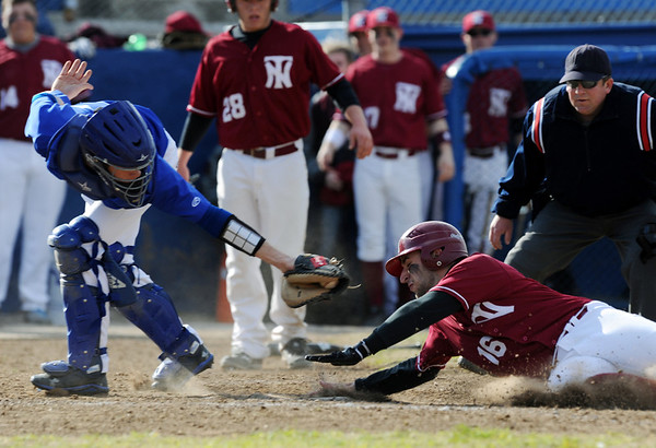Globe/Roger Nomer<br /> Nevada's Alex Payne slides under a tag from Seneca's Cade Cornett to score in Thursday's game at the Bill O'Dell Tournament.