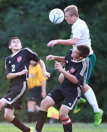 9-10-13<br /> Eastern vs. Taylor soccer<br /> Eastern's Dillon Ryan hits the ball with his head as Taylor's Joey Townsend and Kyle Orzech try to get control of it.<br /> KT photo | Kelly Lafferty