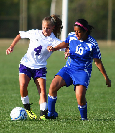 9-5-13<br /> Northwestern vs. Frankfort girls soccer<br /> Northwestern's Hannah Wilson and Frankfort's Esmeralda Valdes battle over control over the ball.<br /> KT photo | Kelly Lafferty