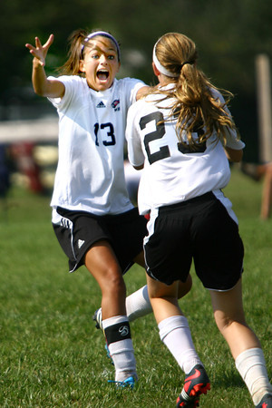 9-7-13  --  Western HS vs Oak Hill Girls Soccer<br /> Western's Chassidy Lenn excited over Sarah Connelly's goal in the second half making it 3-0.<br />    KT photo | Tim Bath