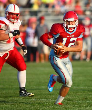 8-30-13<br /> Maconaquah football<br /> Maconaquah's Kyle Dinn runs the ball.<br /> KT photo | Kelly Lafferty