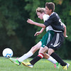 9-10-13<br /> Eastern vs. Taylor soccer<br /> Taylor's Robbie Tebbe and Eastern's Lucas VanMatre battle over control of the ball.<br /> KT photo | Kelly Lafferty