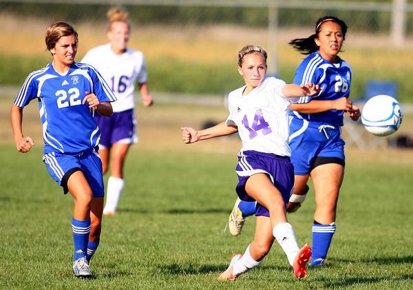 9-5-13<br /> Northwestern vs. Frankfort girls soccer<br /> Northwestern's Korey Price kicks past Frankfort's Lyndsey Isenhower and Adilene Santos.<br /> KT photo   Kelly Lafferty