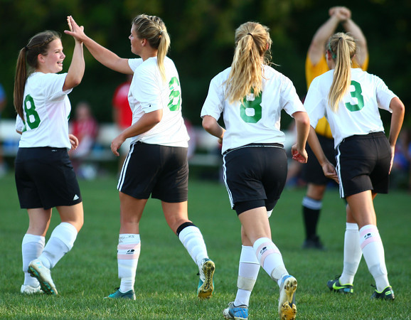 9-11-13<br /> Savannah Rees scores her 100th point in Eastern soccer<br /> Savannah Rees highfives her teammate Emily Harvath after Rees scored her 100th goal.<br /> KT photo | Kelly Lafferty