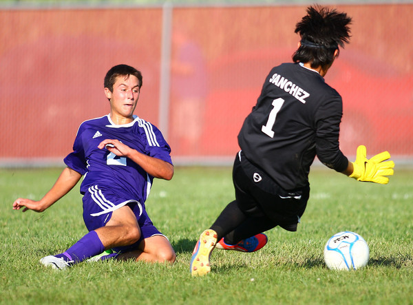 9-4-13<br /> Western vs. Northwestern soccer<br /> Northwestern's Blaine Brutus kicks the ball past Western's Edgar Sanchez to score a point.<br /> KT photo | Kelly Lafferty