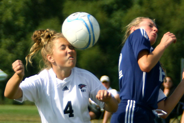 9-7-13  --  Western HS vs Oak Hill Girls Soccer<br /> Western's  Lauren Abney heading the ball with Oak Hills Reagan Brankle trying to do the same.<br />    KT photo | Tim Bath