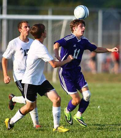 9-4-13<br /> Western vs. Northwestern soccer<br /> Northwestern's Robert Olsen hits the ball off of his head as Western's Braden Browell and Chris Carter go after it.<br /> KT photo | Kelly Lafferty