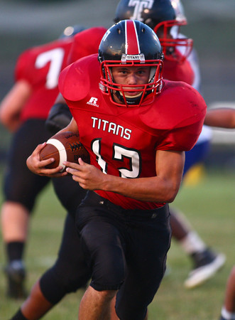 8-30-13<br /> Taylor vs. Tri Central football<br /> Taylor's Austin Smith runs the ball.<br /> KT photo | Kelly Lafferty