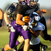 9-13-13  --- Northwestern HS vs Western HS Football<br /> NW's Michael Plummer running up the middle in the first quarter.<br />   KT photo   Tim Bath
