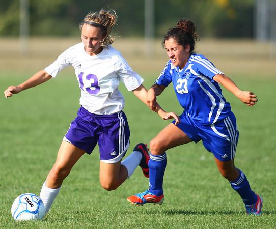9-5-13<br /> Northwestern vs. Frankfort girls soccer<br /> Northwestern's Brandi Harmon keeps the ball away form Frankfort's Flor Valdes.<br /> KT photo | Kelly Lafferty