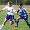 9-5-13<br /> Northwestern vs. Frankfort girls soccer<br /> Northwestern's Brandi Harmon keeps the ball away form Frankfort's Flor Valdes.<br /> KT photo | Kelly Lafferty