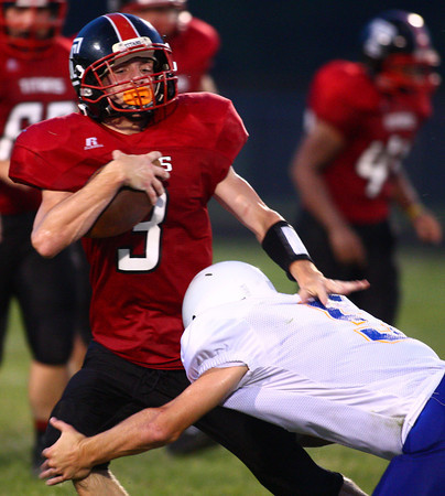 8-30-13<br /> Taylor vs. Tri Central football<br /> Tri-Central's Cody Howell tackles Taylor's Dayne Tomlinson.<br /> KT photo | Kelly Lafferty