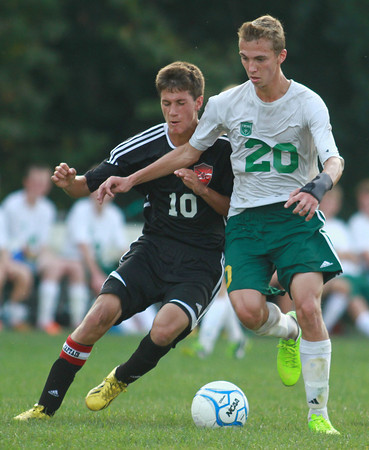 9-10-13<br /> Eastern vs. Taylor soccer<br /> Eastern's Darren Bellow and Taylor's Robbie Tebbe battle over control of the ball.<br /> KT photo | Kelly Lafferty