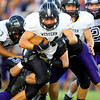 9-13-13  --- Northwestern HS vs Western HS Football<br /> NW's Austin Bowley slowing down Western's Ben Lenahan.<br />   KT photo | Tim Bath