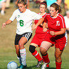 9-11-13<br /> Savannah Rees scores her 100th point in Eastern soccer<br /> Eastern's Savannah Rees keeps the ball away from Maconaquah's Erin Tidd.<br /> KT photo | Kelly Lafferty