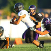 9-13-13  --- Northwestern HS vs Western HS Football<br /> Western's Christian Glenn breaking away from a tackle.<br />   KT photo | Tim Bath