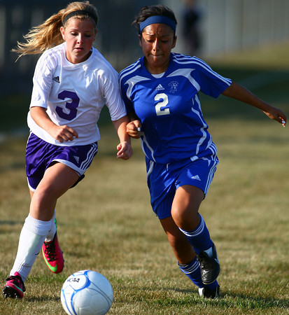 9-5-13<br /> Northwestern vs. Frankfort girls soccer<br /> Northwestern's Bailey Thatcher and Frankfort's Maricela Bautista battle over control over the ball.<br /> KT photo | Kelly Lafferty