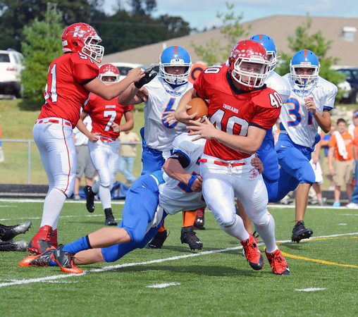 Lawrenceville's Austin Wanke (40) sheds a tackle from Newton's Tanner Shull and continues running up field. Newton lost 48-26 to the Indians on Lawrenceville's Homecoming.