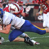 Effingham's Zach Miller lays a hit on Paxton-Buckley-Loda running back Nate Schrodt for a tackle.