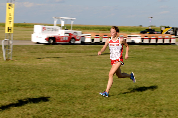 Effingham's Jenna Bingham crosses the finish line in first place during the Lady Hearts' dual meet with St. Anthony at Mid-America Corvette.
