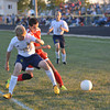 Effingham's Tyler Katz (20) and Teutopolis' Richard Wente (16) battle for position and the ball. Katz scored both goals as Effingham came back in dramatic fashion to down the Wooden Shoes.