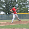 St. Anthony freshman Drew Gibson goes through his delivery and fires a pitch toward an unseen Ramsey batter.