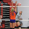 Stew-Stras' Lindsay Burton (14) goes for a kill while Tri-County's Abby Smith (21) defends at the Crossroads Classic.