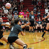 Effingham's Bethany Donaldson (left) and Jennifer Fred (center) each dive for a ball while Josie Zerrusen (pink, right) during the Flaming Hearts' loss to St. Anthony in the Volley for a Cure game.