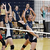 Teutopolis' Michelle Schmidt screams in celebration after her game-winning kill against Sullivan, while the rest of the Lady Shoes celebrate behind her.