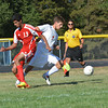 St. Anthony's Benton Hakman (7) dribbles the ball around Effingham's Parth Maheshwari (13) during the teams' matchup.