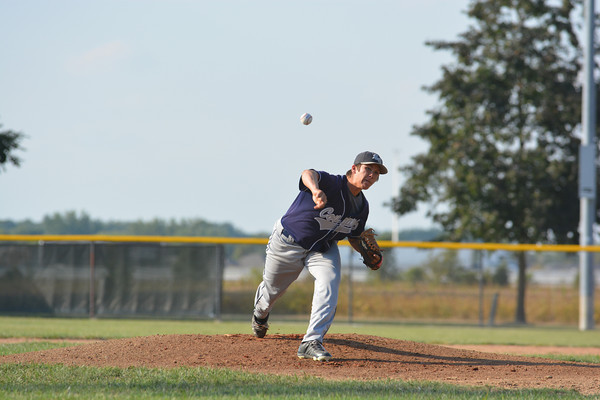 South Central's Dylan Peters watches his pitch fly toward home during the Cougars' 5-4 win against St. Anthony.