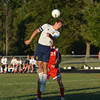 Teutopolis' Kyle Blievernicht (2) strikes a header during the Wooden Shoes' 2-1 loss to Effingham.