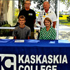 Effingham alumnus Aaron Meyers signed to play tennis at Kaskaskia College recently. With him in the front row is his mother, Terri Meyers. In the back row is Kasksakia coach Valjean Lueking and Aaron's father Gary Meyers.