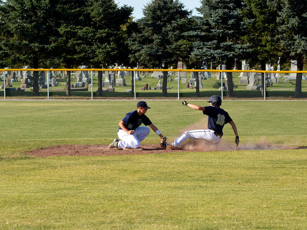 Windsor/Stew-Stras' Chase Theis tags out Teutopolis' Brock Mette when Mette tried to take second on a ball hit to left field. The Shoes beat W/SS 12-1 in five innings at Windsor High School.