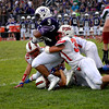 Effingham's Billy Arndt (35) and Travis Durbin (21) tackle a runner from Mascoutah.