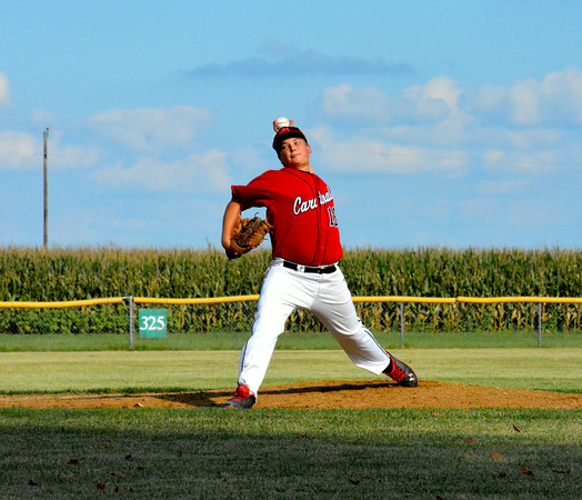 North Clay freshman Jordan Bloemer fires a pitch toward home plate during the Cardinals' win over Windsor/Stew-Stras.