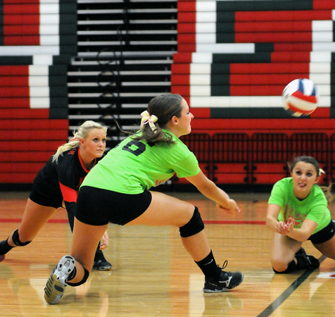 Effingham senior Felicia Totten (16) digs for a ball in the first set against St. Anthony at Effingham High School.
