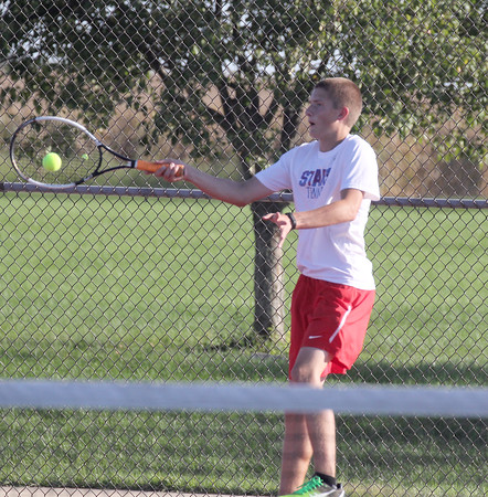 Dylan Hamerin hits a shot in the match at No. 2 doubles on Tuesday.