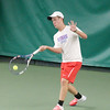 Korbin Lough hits a forehand in his match at No. 1 singles on Friday in the sectional title match against Zionsville.