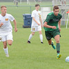 Zionsville's Max Brown chases after a ball against Mooresville.