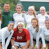 Photo by Debbie Beigh   For the Times Sentinel<br /> <br /> The Zionsville seniors pose with head coach Ramon Aguillon before Wednesday night's game. Back row, (from left) Alex Longsinger, Coach Ramon Aguillon, Abbie Collins, Genevieve Goldthorpe, Caitlin Tanona and Natalie Hummer. Front row (from left): Alex Wendt, Kelly Bachmann, Chloe Jenkins and Isabelle Diagostino.