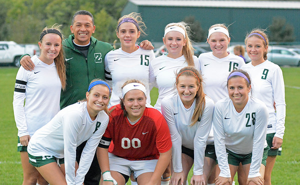 Photo by Debbie Beigh | For the Times Sentinel<br /> <br /> The Zionsville seniors pose with head coach Ramon Aguillon before Wednesday night's game. Back row, (from left) Alex Longsinger, Coach Ramon Aguillon, Abbie Collins, Genevieve Goldthorpe, Caitlin Tanona and Natalie Hummer. Front row (from left): Alex Wendt, Kelly Bachmann, Chloe Jenkins and Isabelle Diagostino.