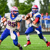 Western Boone's Jack Gilliam rolls out to pass on Friday night.