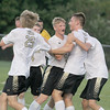 Members of the Lebanon soccer team celebrate with Logan Achor (second right) after Achor's first half goal against Western Boone.