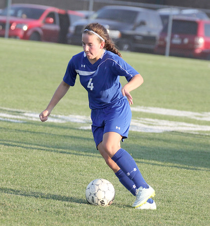 Western Boone's Hillary Reed brings the ball up the field against Lebanon.