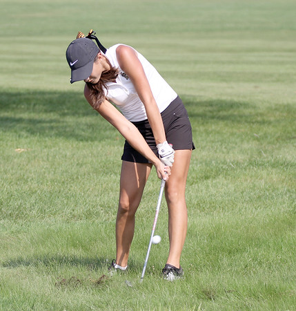 Lebanon's Katherine Patterson chips out of the rough on the 18th hole Saturday at the golf regional. Patterson led the Tigers with an 85.
