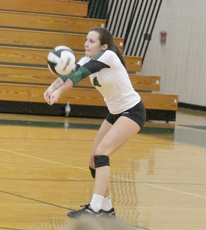Anna Murphy gets a dig in the third set against Westfield.